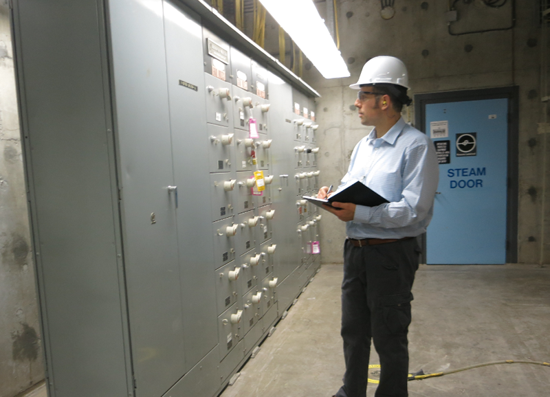 A CNSC expert during inspection of the seismic qualification at a Canadian nuclear power plant