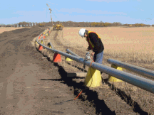 Photograph of a pipeline inspection using industrial radiography equipment.