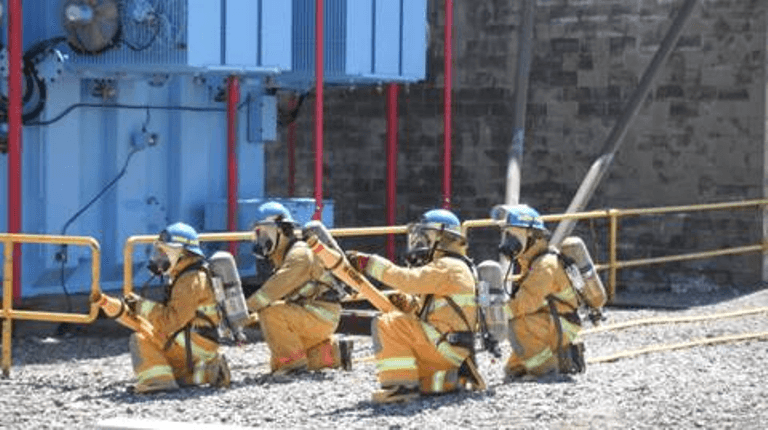 A photograph showing workers at fire protection training at the Point Lepreau Nuclear Generating Station