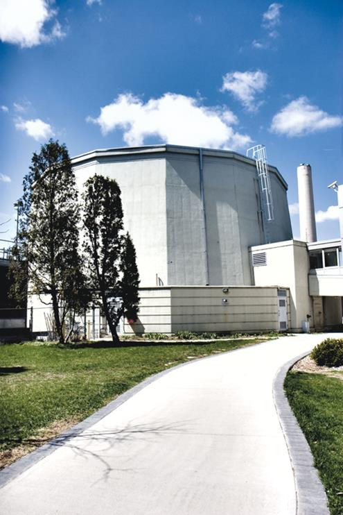 This picture shows a ground-level view of the McMaster Nuclear Reactor facility on the campus of McMaster University in Hamilton, ON