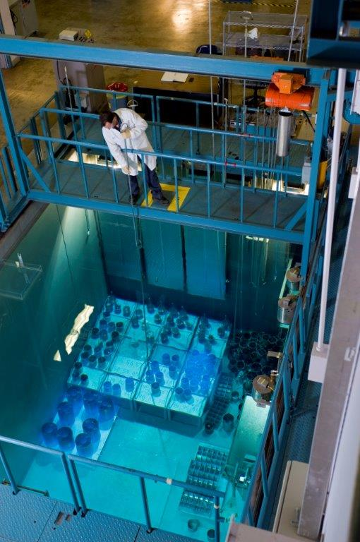 This picture shows a Nordion employee performing an inspection above the cobalt storage pool