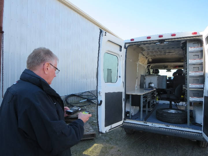 Figure 3: CNSC inspector conducting inspection of a calibration licensee (source: CNSC)