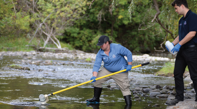 Figure 2: CNSC environmental program officers collect samples for analysis