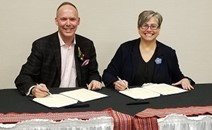 CNSC Vice-President and Chief Communications Officer Jason Cameron and MNO President Margaret Froh sign terms of reference in Owen Sound, Ontario