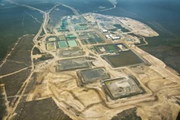Aerial image of McArthur River operation with waste rock pads 1-4 in the middle foreground