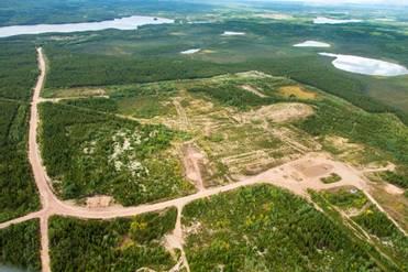 Image of Cluff Lake tailings management area after decommissioning, but before vegetation became re-established