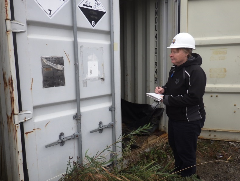 Image of a CNSC inspector conducting an inspection of low-level waste storage area at waste nuclear substance licensee.